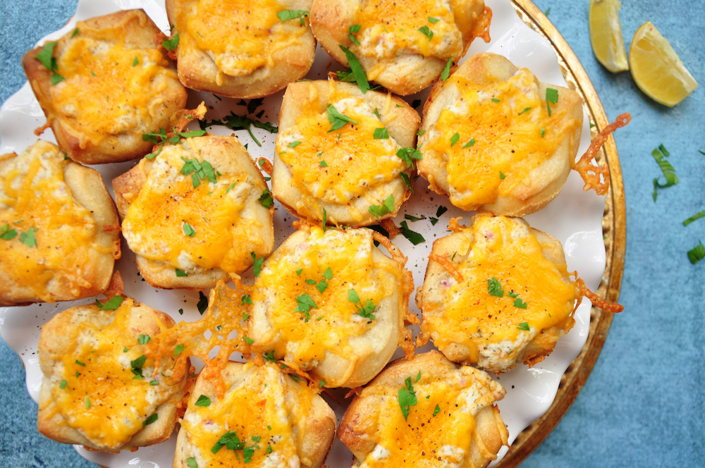 Cheese, crab, herbs and lemon, plus a pizza crust shaped into muffin cups, these cheesy crab appetizers are super fun and quick to make.