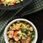 Cauliflower rice fried w/ loads of veggies & kielbasa in a tasty gluten-free sauce. It's a savory low-carb meal you can make for your family in 30 minutes.
