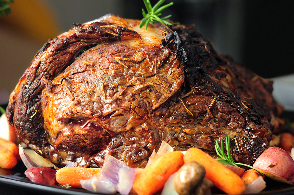Beef rib roast rubbed with dijon mustard, rosemary, and steak seasoning blend, then roasted under a low temperature for the perfect tenderness. Pair it with an easy chimichurri sauce, this dijon and herb rubbed roast is going to steal the spotlight on your holiday table.
