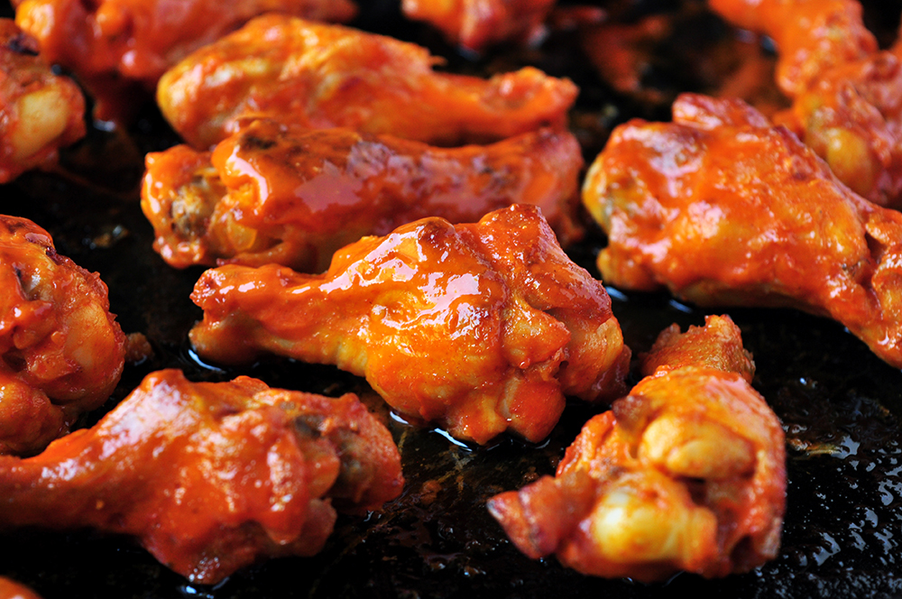 These buffalo-style grilled chicken wings take 20 minutes on the grill and they are finger lickin' good! You can also broil them in the oven.