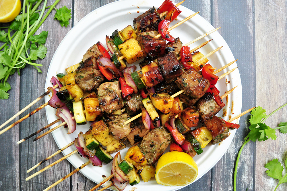 Grilled tuna, red onions, bell peppers, pineapples and zucchini on skewers, these tuna kabobs are basted and served with an amazing pineapple glaze. Yum!
