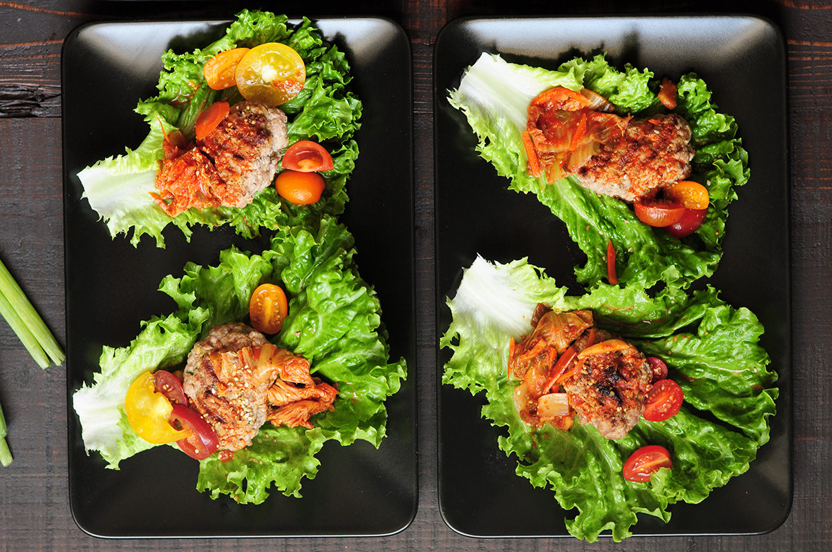 Easy lettuce wraps featuring grilled ground beef patties and kimchi. It takes less than 30 minutes to put this delicious Korean-style appetizer on the table.