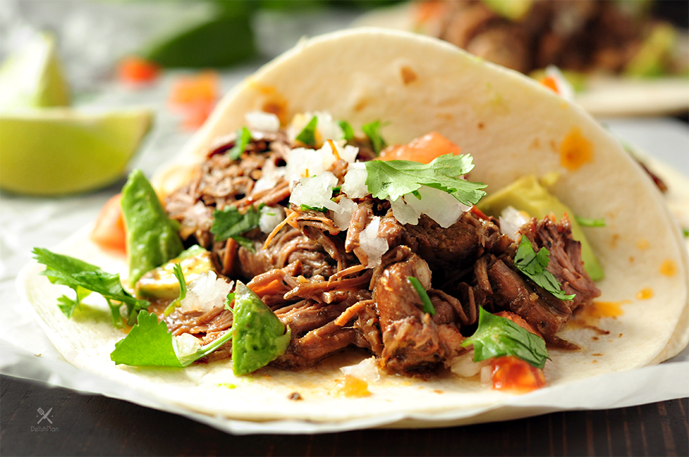 Extremely tender beef barbacoa slow-cooked in a super savory sauce. This recipe only takes 5 mins of hands-on time. Enjoy barbacoa tacos anytime!