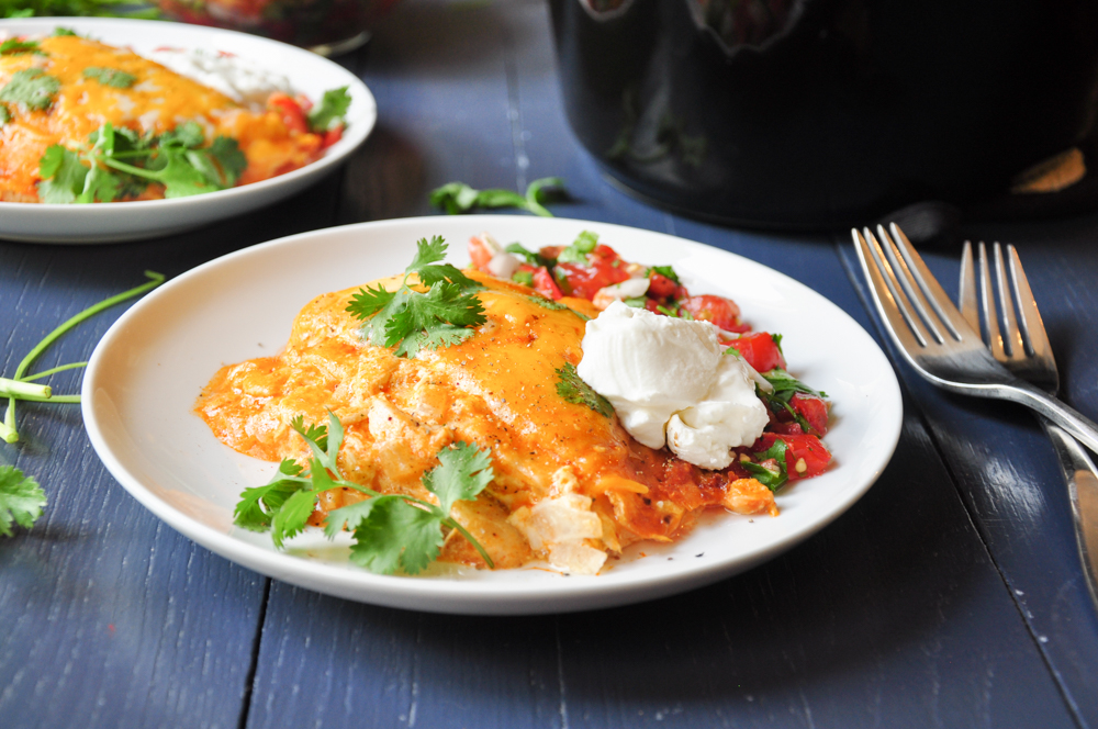 Cheesy and tasty chicken enchiladas stacked in a slow cooker. It's easy to prepare and a great way to use up leftover chicken or meat.